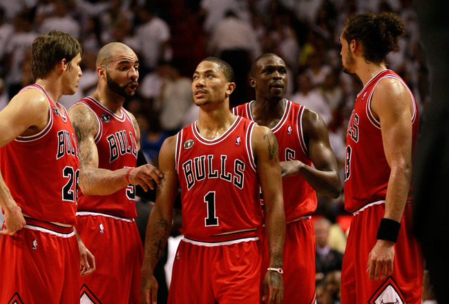 MIAMI, FL - MAY 24:  (L-R) Kyle Korver #26, Carlos Boozer #5, Derrick Rose #1, Luol Deng #9 and Joakim Noah #13 of the Chicago Bulls talk on court against the Miami Heat in Game Four of the Eastern Conference Finals during the 2011 NBA Playoffs on May 24,