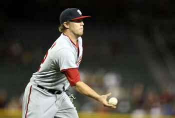 PHOENIX, AZ - JUNE 02:  Relief pitcher Drew Storen #22 of the Washington Nationals pitches against the Arizona Diamondbacks during the Major League Baseball game at Chase Field on June 2, 2011 in Phoenix, Arizona. The Nationals defeated the Diamondbacks 6