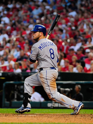 ST. LOUIS, MO - JUNE 18: Mike Moustakas #8 of the Kansas City Royals follows through on a base hit against the St. Louis Cardinals at Busch Stadium on June 18, 2011 in St. Louis, Missouri.  (Photo by Jeff Curry/Getty Images)