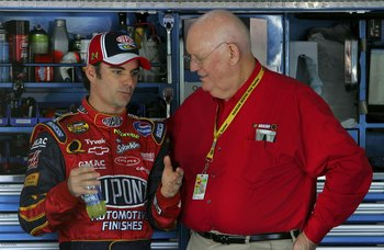 CONCORD, NC - OCTOBER 13:  Jeff Gordon, driver of the #24 DuPont Chevrolet, talks with TV Analyst Benny Parsons, in the garage, during practice for the NASCAR Nextel Cup Series Bank of America 500 on October 13, 2006 at Lowe's Motor Speedway in Concord, N