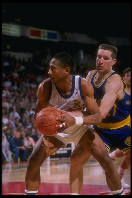1989-1990:  Guard Alex English #2 of the Denver Nuggets screens forward Chris Mullin of the Golden State Warriors from the ball during a game at the McNichols Sports Arena in Denver, Colorado. Mandatory Credit: Tim DeFrisco  /Allsport Mandatory Credit: Ti