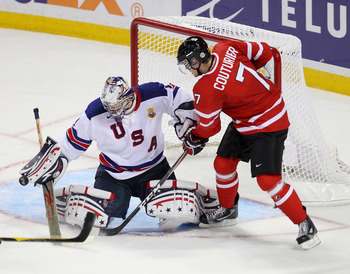 BUFFALO, NY - JANUARY 03:  Jack Campbell #1 of the United States makes a save on Sean Couturier #7 of Canada during the 2011 IIHF World U20 Championship Semi Final game between United States and Canada on January 3, 2011 in Buffalo, New York.  (Photo by R