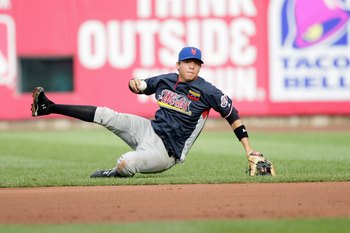 ST. LOUIS, MO - JULY 12:  World Futures All-Star Wilmer Flores of the New York Mets fields during the 2009 XM All-Star Futures Game at Busch Stadium on July 12, 2009 in St. Louis, Missouri. (Photo by Jamie Squire/Getty Images)