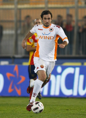 LECCE, ITALY - MARCH 04:  Mirko Vucinic of Roma during the Serie A match between US Lecce and AS Roma at Stadio Via del Mare on March 4, 2011 in Lecce, Italy.  (Photo by Maurizio Lagana/Getty Images)