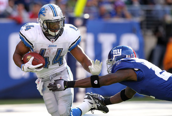 EAST RUTHERFORD, NJ - OCTOBER 17:  Jahvid Best #44 of the Detroit Lions rushes past the tackle of Kenny Phillips #21 of the New York Giants at New Meadowlands Stadium on October 17, 2010 in East Rutherford, New Jersey.  (Photo by Nick Laham/Getty Images)
