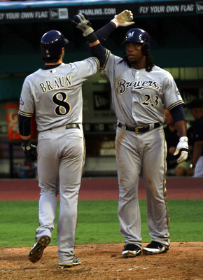 MIAMI GARDENS, FL - JUNE 06: Rickie weeks #23 of the Milwaukee Brewers celebrates a three run home runby Prince Fielder with teammate Ryan Braun #8 against the Florida Marlins at Sun Life Stadium on June 6, 2011 in Miami Gardens, Florida.  (Photo by Marc