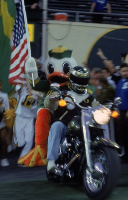 22 Sep 2001:  The Mascot of the Oregon Ducks riding on the back of a motorcycle carrying the flag during the game against the University of Southern California (USC) Trojans at the Autzen Stadium in Eugene, Oregon.  The Ducks defeated the Trojans 24-22. M