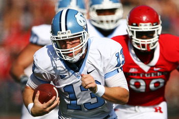 NEW BRUNSWICK, NJ - SEPTEMBER 25:  T.J. Yates #13 of the North Carolina Tar Heels runs the ball against the Rutgers Scarlet Knights at Rutgers Stadium on September 25, 2010 in New Brunswick, New Jersey.  (Photo by Andrew Burton/Getty Images)