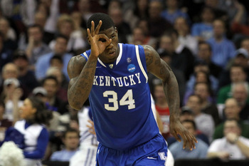 NEWARK, NJ - MARCH 27:  DeAndre Liggins #34 of the Kentucky Wildcats celebrates after a play against the North Carolina Tar Heels during the second half of the east regional final of the 2011 NCAA men's basketball tournament at Prudential Center on March