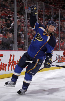 DETROIT, MI - MARCH 30:  Chris Porter #32 of the St. Louis Blues celebrates a third-period goal while playing the Detroit Red Wings at Joe Louis Arena on March 30, 2011 in Detroit, Michigan. St. Louis won the game 10-3.  (Photo by Gregory Shamus/Getty Ima