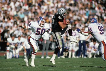 LOS ANGELES, CA - NOVEMBER 2:  Todd Christensen #46 of the Los Angeles Raiders makes a catch against Jim Ryan #50 of the Denver Broncos during the game at the Los Angeles Memorial Coliseum on November 2, 1986 in Los Angeles, California.  The Broncos won 2