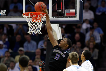 CHARLOTTE, NC - MARCH 20:  Matthew Bryan-Amaning #11 of the Washington Huskies dunks the ball in the second half while taking on the North Carolina Tar Heels during the third round of the 2011 NCAA men's basketball tournament at Time Warner Cable Arena on