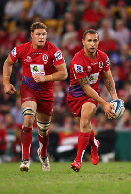 BRISBANE, AUSTRALIA - JUNE 04: Quade Cooper of the Reds runs with the ball during the round 16 Super Rugby match between the Reds and the Brumbies at Suncorp Stadium on June 4, 2011 in Brisbane, Australia.  (Photo by Jonathan Wood/Getty Images)