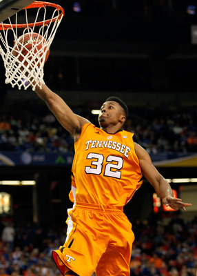 ATLANTA, GA - MARCH 10:  Scotty Hopson #32 of the Tennessee Volunteers shoots against the Arkansas Razorbacks during the first round of the SEC Men's Basketball Tournament at the Georgia Dome on March 10, 2011 in Atlanta, Georgia.  (Photo by Kevin C. Cox/