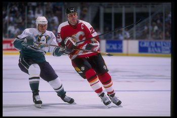 26 Feb 1995: Rightwinger Joe Sacco of the Anaheim Mighty Ducks and Joe Nieuwendyk of the Calgary Flames move down the ice during a game at Arrowhead Pond in Anaheim, California. The Flames won the game, 5-3.