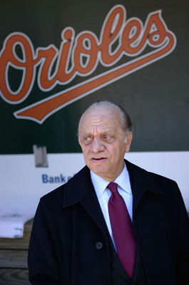 BALTIMORE - APRIL 4:  Owner Peter Angelos of the Baltimore Orioles watches pregame festivities from the duggout prior to the Baltimore Orioles defeating the Oakland Athletics 4-0 on opening day, April 4, 2005 at Oriole Park at Camden Yards in Baltimore, M