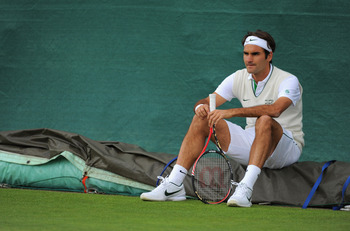WIMBLEDON, ENGLAND - JUNE 19: Roger Federer of Switzerland trains ahead of the Wimbledon Lawn Tennis Championships on June 19, 2011 in Wimbledon, England.  (Photo by Michael Regan/Getty Images)