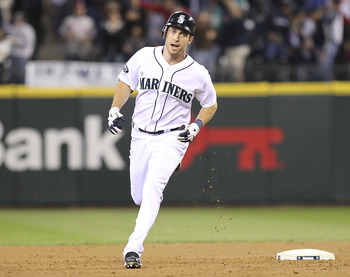 SEATTLE - JUNE 18:  Dustin Ackley #13 of the Seattle Mariners rounds the bases after hitting his first Major League home run in the second inning against the Philadelphia Phillies at Safeco Field on June 18, 2011 in Seattle, Washington. (Photo by Otto Gre
