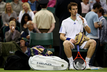 LONDON, ENGLAND - JUNE 20:  Andy Murray of Great Britain takes a break during his first round match against Daniel Gimeno-Traver of Spain on Day One of the Wimbledon Lawn Tennis Championships at the All England Lawn Tennis and Croquet Club on June 20, 201