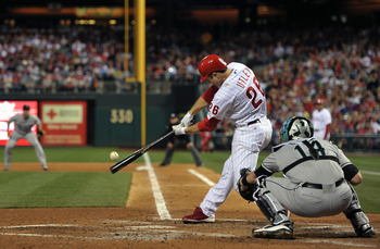 PHILADELPHIA, PA - JUNE 14: Chase Utley #26 of the Philadelphia Phillies hits a double during the game against the Florida Marlins at Citizens Bank Park on June 14, 2011 in Philadelphia, Pennsylvania. (Photo by Drew Hallowell/Getty Images)