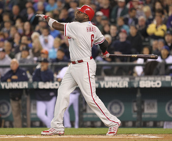 SEATTLE - JUNE 18:  Ryan Howard #6 of the Philadelphia Phillies hits a RBI sacrifice fly in the first inning to take a 1-0 lead against the Seattle Mariners at Safeco Field on June 18, 2011 in Seattle, Washington. (Photo by Otto Greule Jr/Getty Images)