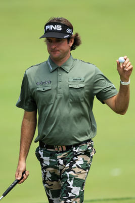 BETHESDA, MD - JUNE 16:  Bubba Watson waves to the gallery on the fifth green during the first round of the 111th U.S. Open at Congressional Country Club on June 16, 2011 in Bethesda, Maryland.  (Photo by David Cannon/Getty Images)