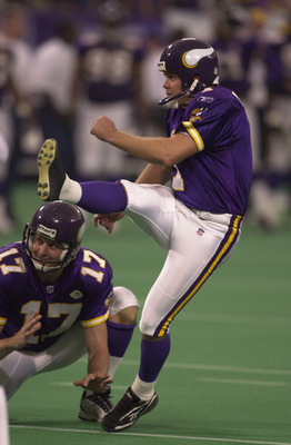 30 Sep 2001: Gary Anderson #1 of the Minnesota Vikings kicks a field goal as Mitch Berger #17 holds the ball during the game against the Tampa Bay Buccaneers at the Hubert H. Humphrey Metrodome in Minneapolis, Minnesota. The Vikings won 20-16. DIGITAL IMA