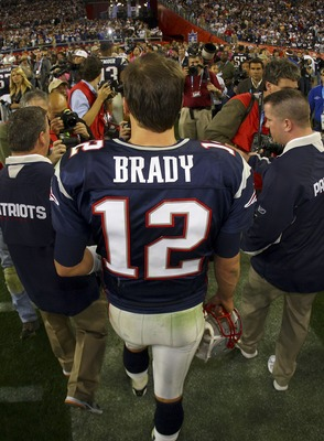 GLENDALE, AZ - FEBRUARY 03:  Tom Brady #12 of the New England Patriots, walks off the field after losing to the New York Giants 17-14 in Super Bowl XLII on February 3, 2008 at the University of Phoenix Stadium in Glendale, Arizona.  (Photo by Donald Miral
