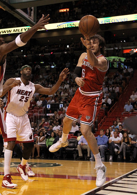 MIAMI, FL - APRIL 06:  Andrew Bogut #6 of the Milwaukee Bucks passes away from  Eric Dampier #25 of the Miami Heat during a game at American Airlines Arena on April 6, 2011 in Miami, Florida. NOTE TO USER: User expressly acknowledges and agrees that, by d