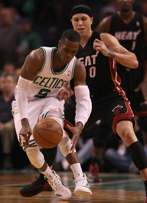 BOSTON, MA - MAY 09:  Rajon Rondo #9 of the Boston Celtics tries to keep the ball from Mike Bibby #0 of the Miami Heat in Game Four of the Eastern Conference Semifinals in the 2011 NBA Playoffs on May 9, 2011 at the TD Garden in Boston, Massachusetts.  Th