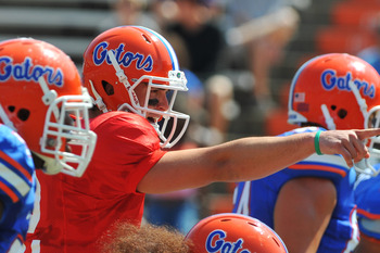 GAINESVILLE, FL - APRIL 9:  Quarterback John Brantley #12 of the Florida Gators directs play the Orange and Blue spring football game April 9, 2011 at Ben Hill Griffin Stadium in Gainesville, Florida.  (Photo by Al Messerschmidt/Getty Images)