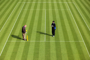 WIMBLEDON, ENGLAND - JUNE 18:  Groundstaff use an instrument to check the bounciness of the grass courts at the All England Lawn Tennis and Croquet Club ahead of the Wimbledon Lawn Tennis Championships on June 18, 2011 in London, England. The Championship