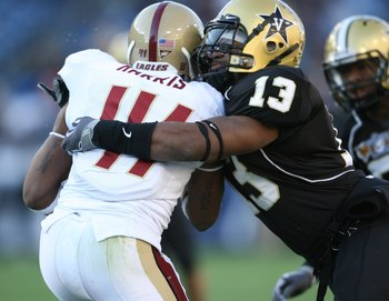 NASHVILLE, TN - DECEMBER 31:  Chris Marve #13 of the Vanderbilt Commodores tackles Montel Harris #41 of the Boston College Eagles during the Gaylord Hotels Music City Bowl at LP Field on December 31, 2008 in Nashville, Tennessee.  (Photo by Andy Lyons/Get