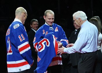 NEW YORK - FEBRUARY 22: Former New York Ranger players Mark Messier, Andy Bathgate and Adam Graves look over Bathgate's jersey during a ceremony prior to the game between the Toronto Maple Leafs and the New York Rangers on February 22, 2009 at Madison Squ