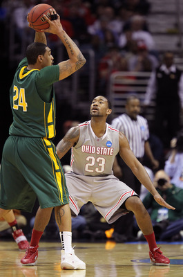 CLEVELAND, OH - MARCH 20: David Lighty #23 of the Ohio State Buckeyes defends Ryan Pearson #24 of the George Mason Patriots during the third of the 2011 NCAA men's basketball tournament at Quicken Loans Arena on March 20, 2011 in Cleveland, Ohio.  (Photo