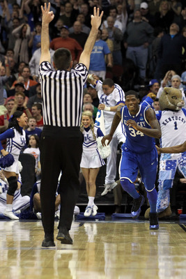 NEWARK, NJ - MARCH 27:  DeAndre Liggins #34 of the Kentucky Wildcats celebrates after shooting a three pointer against the North Carolina Tar Heels during the second half of the east regional final of the 2011 NCAA men's basketball tournament at Prudentia