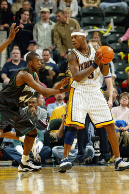 INDIANAPOLIS - NOVEMBER 25:  Al Harrington #3 of the Indiana Pacers looks to make a play against Ndudi Ebi #44of the Minnesota Timberwolves during the game on November 25, 2003 at Conseco Fieldhouse in Indianapolis, Indiana. The Pacers won 98-75.   NOTE T
