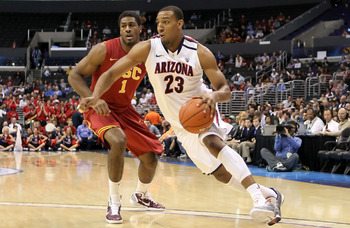 LOS ANGELES, CA - MARCH 11:  Derrick Williams #23 of the Arizona Wildcats drives on Alex Stepheson #1 of the USC Trojans in the first half in the semifinals of the 2011 Pacific Life Pac-10 Men's Basketball Tournament at Staples Center on March 11, 2011 in