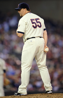 MINNEAPOLIS, MN - JUNE 18: Matt Capps #55 of the Minnesota Twins prepares to deliver a pitch against the San Diego Padres in the ninth inning against the San Diego Padres in  on June 18, 2011 at Target Field in Minneapolis, Minnesota. The Twins defeated t
