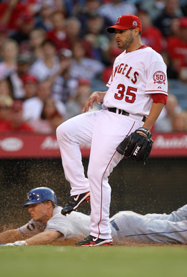 ANAHEIM, CA - JUNE 11: Pitcher Joel Pineiro #35 of the Los Angeles Angels of Anaheim covers home on his passed ball as Chris Getz #17 of the Kansas City Royals scores in the third inning on June 11, 2011 at Angel Stadium in Anaheim, California.  (Photo by