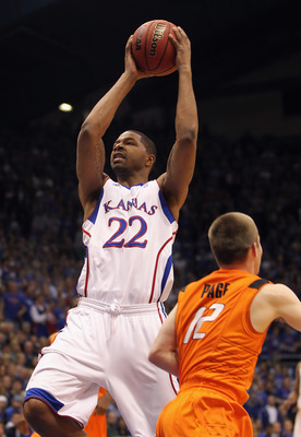 LAWRENCE, KS - FEBRUARY 21:  Marcus Morris #22 of the Kansas Jayhawks shoots during the game against the Oklahoma State Cowboys on February 21, 2011 at Allen Fieldhouse in Lawrence, Kansas.  (Photo by Jamie Squire/Getty Images)