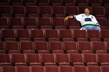 VANCOUVER, BC - JUNE 15:  A Vancouver Canucks fan sits in empty seats after the Vancouver Canucks were defeated by the Boston Bruins in Game Seven of the 2011 NHL Stanley Cup Final at Rogers Arena on June 15, 2011 in Vancouver, British Columbia, Canada. T