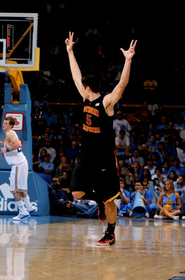 WESTWOOD, CA - JANUARY 16:  Nikola Vucevic #5 of the USC Trojans celebrates making a three point basket in the game against the UCLA Bruins on January 16, 2010 at Pauley Pavillion in Westwood, California.  USC won 67-46.  (Photo by Stephen Dunn/Getty Imag