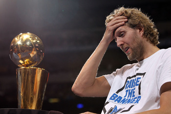 DALLAS, TX - JUNE 16:  Dirk Nowitzki of the Dallas Mavericks gets emotional after the Dallas Mavericks Victory Parade at American Airlines Center on June 16, 2011 in Dallas, Texas.  (Photo by Ronald Martinez/Getty Images)