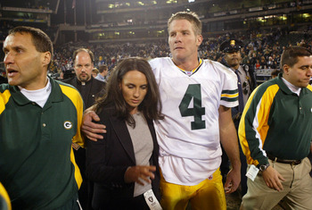 OAKLAND, CA - DECEMBER 22:  Brett Favre #4 of the Green Bay Packers leaves the field with his wife Deanne after defeating the Oakland Raiders after an NFL game on December 22, 2003  at the Network Associates Coliseum in Oakland, California.  (Photo by Jed