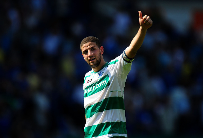 CARDIFF, WALES - APRIL 23:  QPR  player Adel Taarabt acknowledges the fans at the end of the npower Championship game between Cardiff City and Queens Park Rangers at Cardiff City Stadium on April 23, 2011 in Cardiff, Wales.  (Photo by Stu Forster/Getty Im