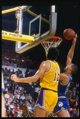 1990:  Center Felton Spencer of the Minnesota Timberwolves goes up for two during a game against the Los Angeles Lakers at the Great Western Forum in Inglewood, California. Mandatory Credit: Ken Levine  /Allsport