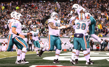EAST RUTHERFORD, NJ - DECEMBER 12: The Miami Dolphins celebrate the touchdown of Brandon Marshall #19 against the New York Jets at New Meadowlands Stadium on December 12, 2010 in East Rutherford, New Jersey.  (Photo by Nick Laham/Getty Images)