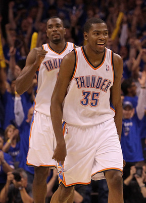 OKLAHOMA CITY, OK - MAY 23:  Kevin Durant #35 and Serge Ibaka #9 of the Oklahoma City Thunder react in the fourth quarter while taking on the Dallas Mavericks in Game Four of the Western Conference Finals during the 2011 NBA Playoffs at Oklahoma City Aren