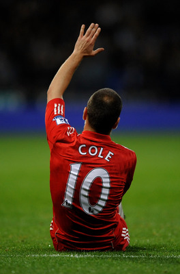 BOLTON, ENGLAND - OCTOBER 31:  Joe Cole of Liverpool gestures after sustaining an injury during the Barclays Premier League match between Bolton Wanderers and Liverpool at the Reebok Stadium on October 31, 2010 in Bolton, England.  (Photo by Laurence Grif
